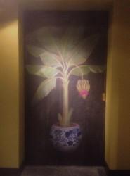 Bananenplant op schuifdeur